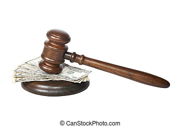 Gavel and money - Wooden gavel and dollars bills from the...