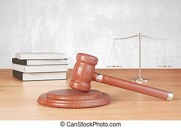 Gavel and scales on the wooden table