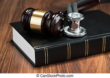 Gavel And Stethoscope On Book - Close-up Of Gavel And...