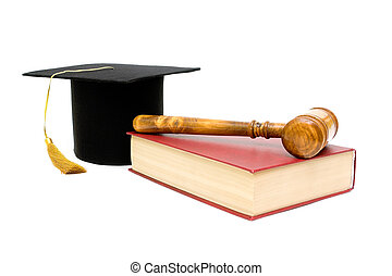 gavel, book and a graduate hat on a white background