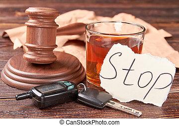 Gavel, car keys, glass of alcohol.