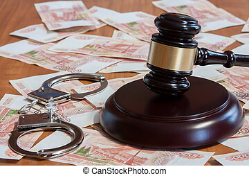 Gavel, handcuffs and Russian money