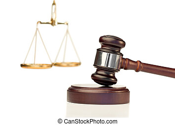 Gavel in action and scale of justice on a white background