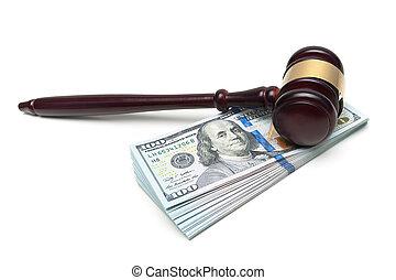 gavel lying on a big stack of money isolated on white background