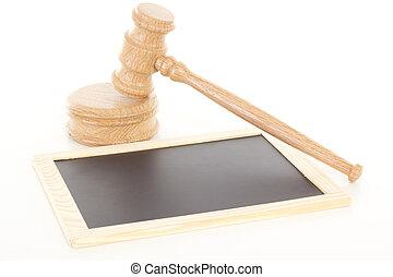 Gavel made of oak wood with blank blackboard