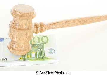 Gavel made of oak wood with some money