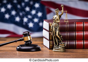 Gavel Near Books With Golden Scale