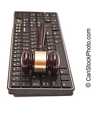 Gavel on black computer keyboard
