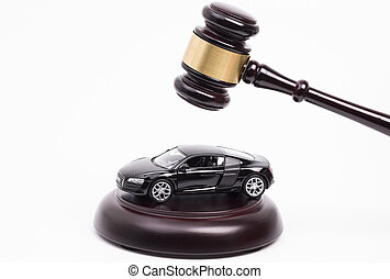Image shows a wooden gavel on car isolated on white background