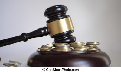 Gavel pownding at a financial or business lawsuit with coins