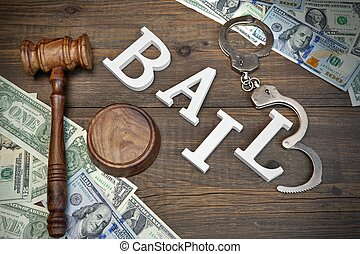 Gavel, Sign BAIL, Handcuffs And Dollar Cash On Wood...
