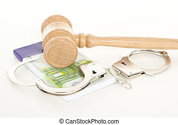 Gavel with money and handcuffs