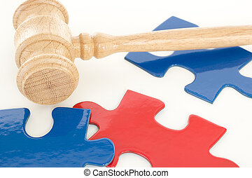 Gavel with some colorful puzzle pieces