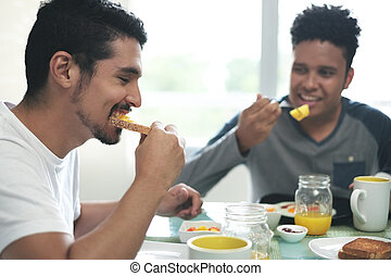 Gay Couple Eating Breakfast At Home In the Morning