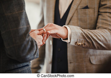 Gay Couple Exchanging Rings On Wedding Day