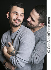 Gay couple on black background - A gay couple on black...