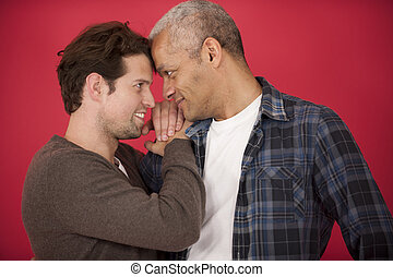 Gay couple on red background - Happy gay couple in love on...