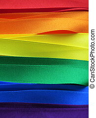 Gay Flag flag or banner made with red, orange, yellow, green, blue and purple ribbons