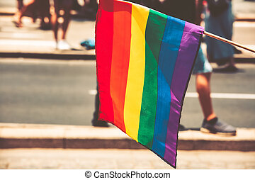 Gay flag on the street background. Big rainbow flag