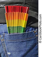 gay hand fan in the back pocket