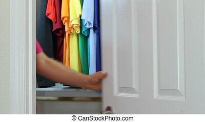 Gay Man Coming Out of the Closet - Adult male dressed in a...