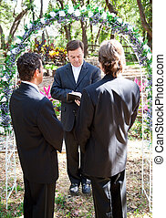 Gay Marriage Ceremony - Gay couple being married by their...
