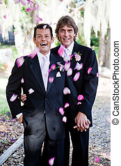 Gay Marriage - Showers of Petals - Gay wedding couple being...