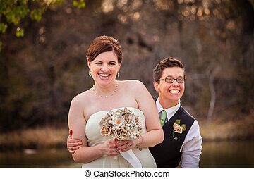Cute newlywed gay couple laughing together