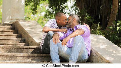 Gay People Two Men Kissing On Stairs In Park - Homosexual...