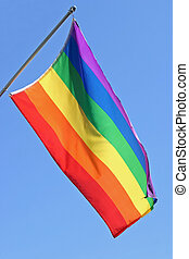 Gay Pride Flag - A gay pride flag waving in the wind against...