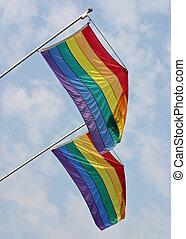 Gay Pride Flags - Two gay pride flags waving in the wind