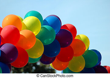 Gay Pride Rainbow Balloons - A string of rainbow colored...