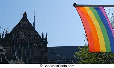 Gay pride rainbow flag LGBT flying. A multi-colored rainbow...