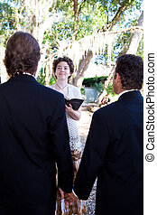 Gay Wedding Ceremony - Gay male couple getting married by a...