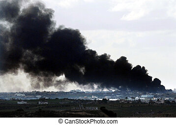 GAZA STRIP - JANUARY 09: Big black smoke over Gaza Strip during Cast Lead operation on January 09 2009.It was a three-week armed conflict in the Gaza Strip during the winter of 2008-2009.