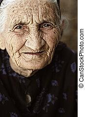 Gaze of senior woman closeup face photo outdoors