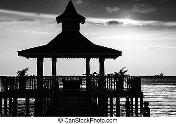 gazebo bridge sea at sunset monochrome