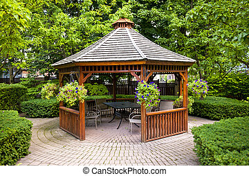 Gazebo in garden - Gazebo in landscaped garden with...