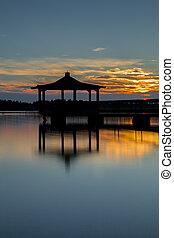 Gazebo in Lake with Sunset