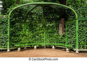 gazebo with bench in Park Summer Garden, St.Petersburg, Russia.