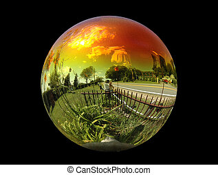 View of the world through a gazing ball isolated on a black background
