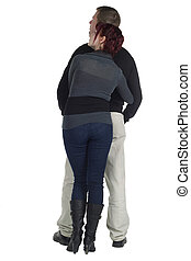 Back view portrait of romantic couple gazing upward over a white background