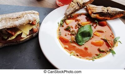 gazpacho soup, salads and drink at restaurant - food, haute...