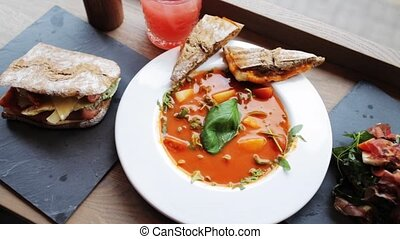 gazpacho soup, salads and drink at restaurant