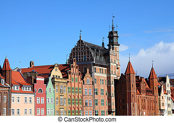 Poland - Gdansk city (also know nas Danzig) in Pomerania region. Famous apartment buildings next to Motlawa river.