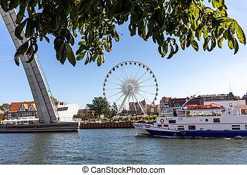 The Draw Footbridge over the Mot?awa River and Ferris wheel on the Olowianka Island in Gdansk