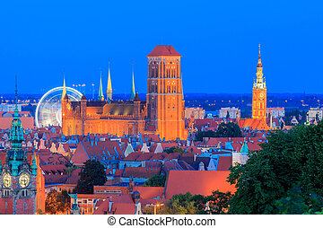 View of the historic center of Gdansk, and St. Mary's Church at night.