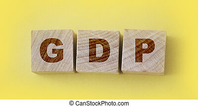 GDP Gross Domestic Product word made with wooden blocks concept