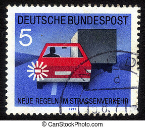 GDR (EAST GERMANY) - CIRCA 1971: a stamp printed in GDR (East Germany) shows car, truck and light signal, devoted to the explaining rules of the road, series Road safety, circa 1971