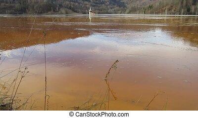 Geamana lake and flooded church near Rosia Montana Romania